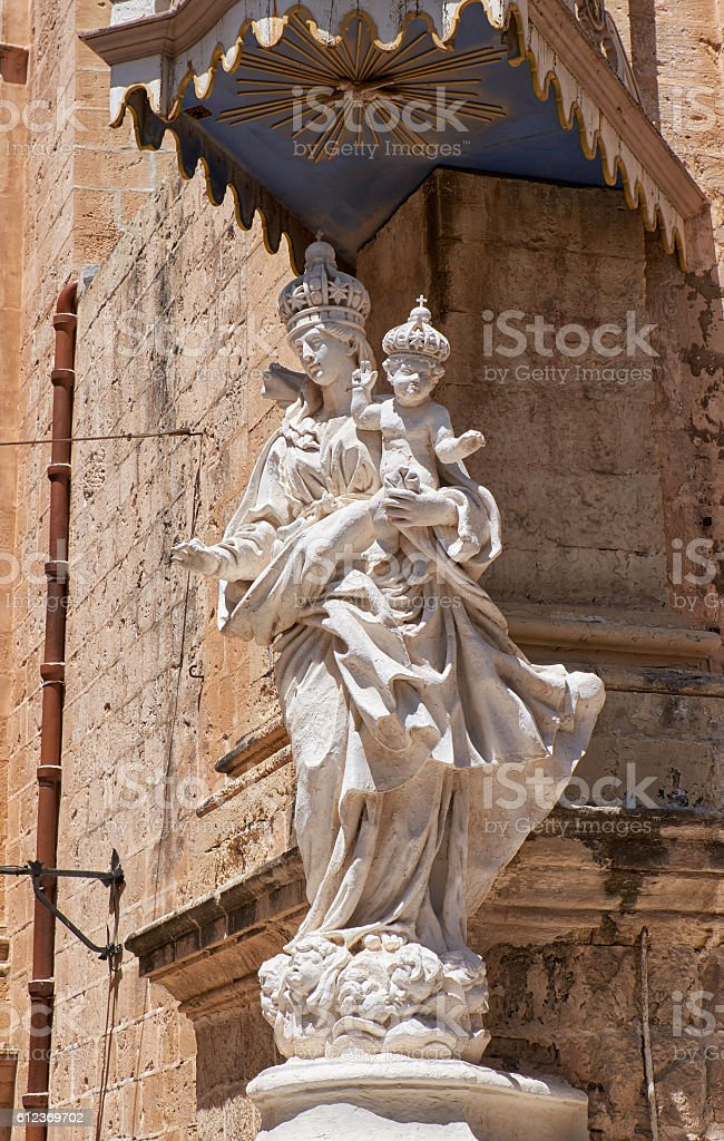 Statue of Virgin Mary with Jesus child near Carmelite stock photo