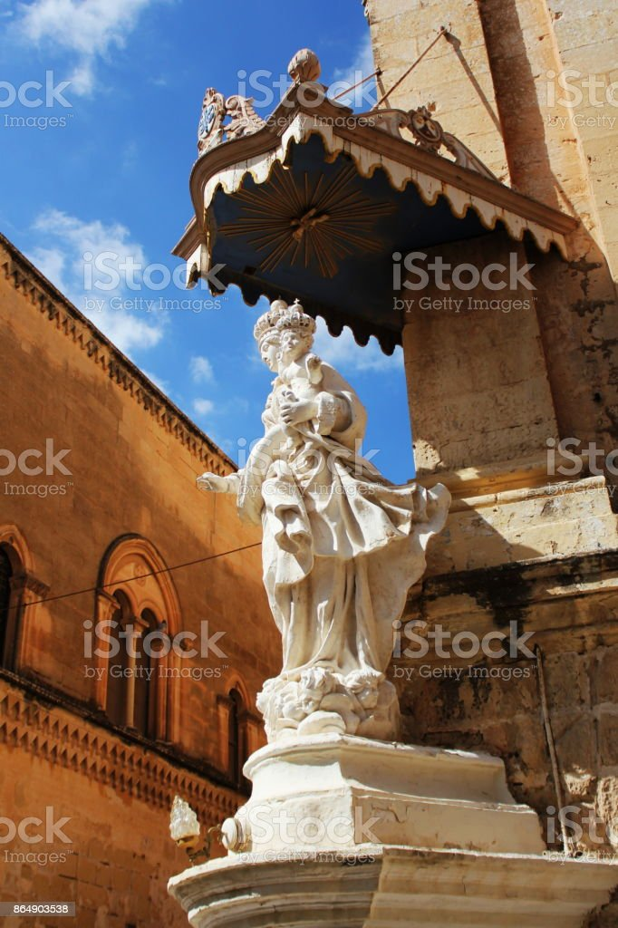 Statue of Virgin Mary with Jesus child on the corner of Carmelite Priory in Mdina. Malta stock photo