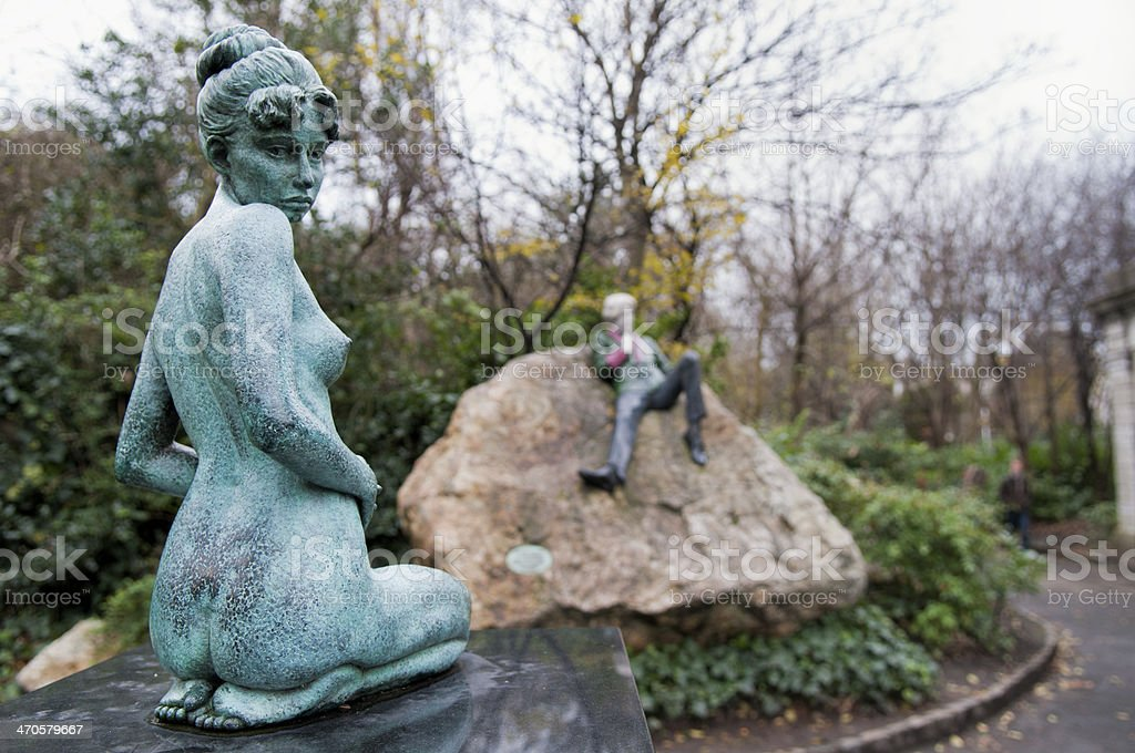 Statue of woman in Dublin's Merrion Square (Archbishop Ryan Park) royalty-free stock photo