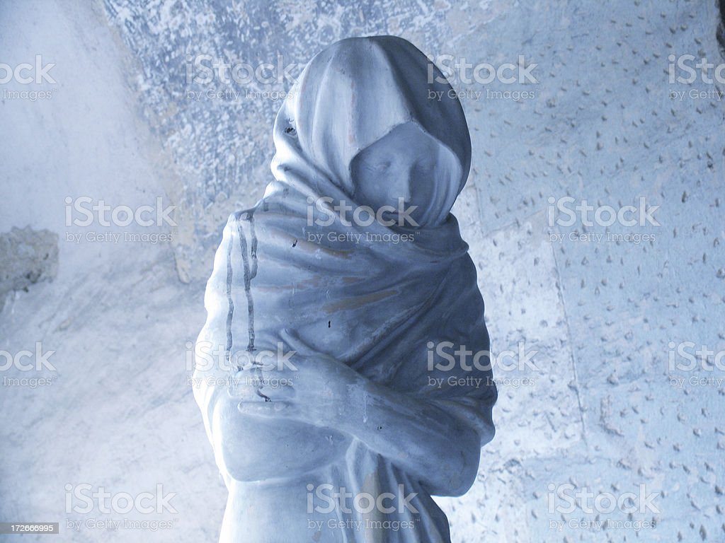 Statue on a tomb stone royalty-free stock photo