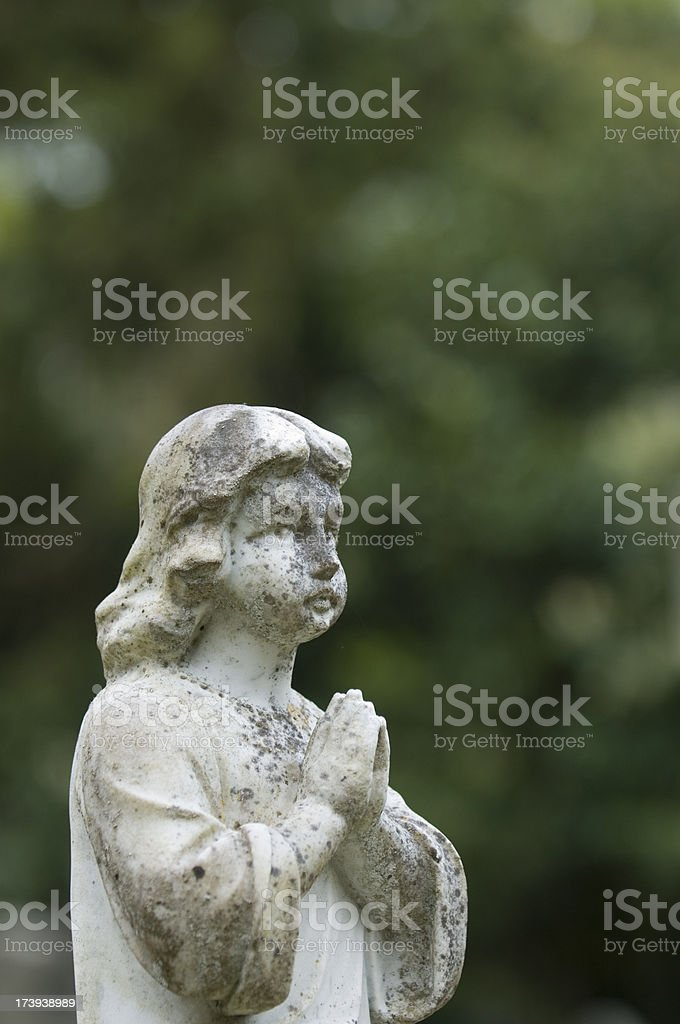 Statue on gravestone in cemetery royalty-free stock photo