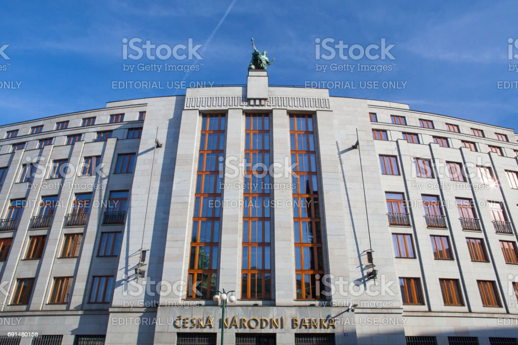 Statue on roof of entrance to the bank Czech National Bank stock photo