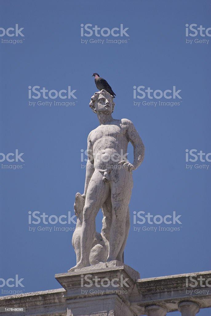 Statue on the Biblioteca Nazionale Marciana stock photo