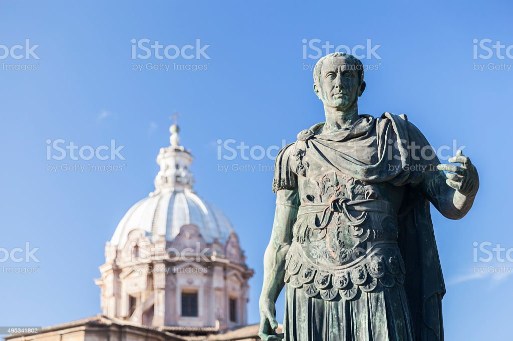 Statue Roman Emperor in front of church in Rome stock photo
