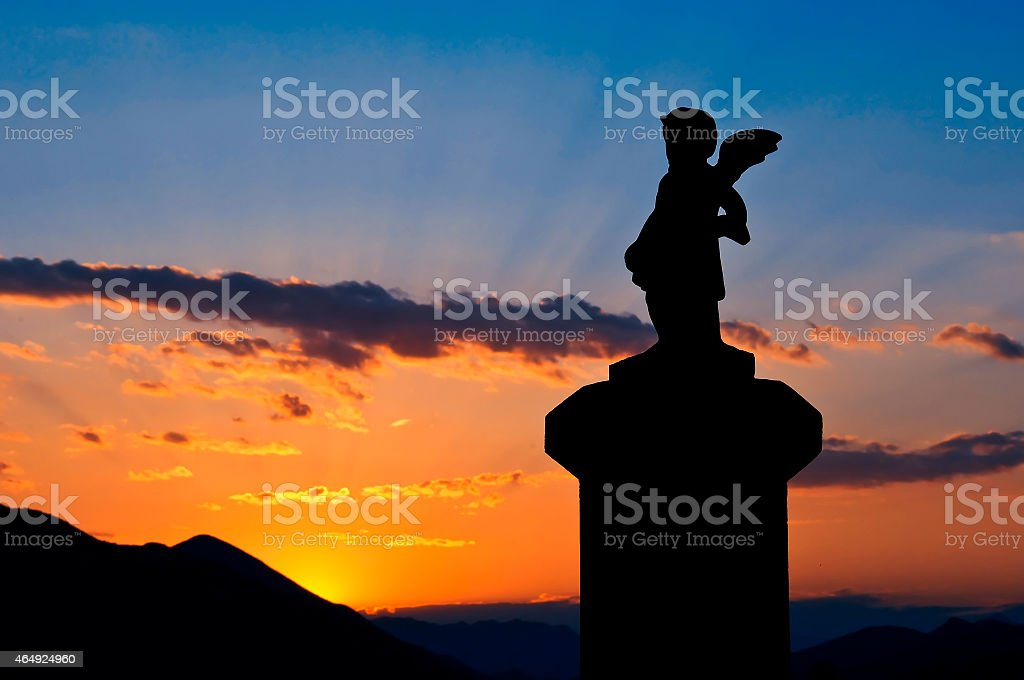 Statue silhouette at sunset stock photo