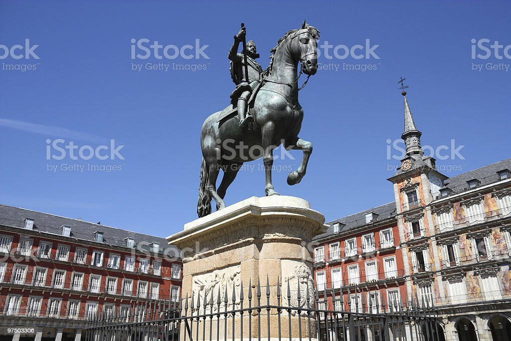 Statue surrounded by buildings in Madrid royalty-free stock photo