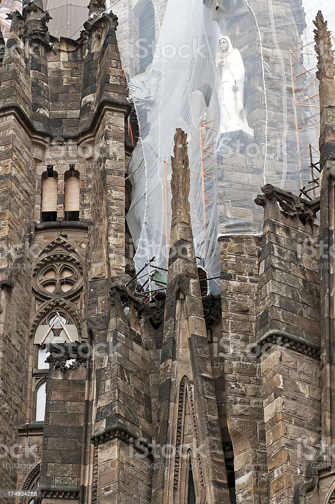 Statue under netting during construction of cathedral in Barcelona royalty-free stock photo