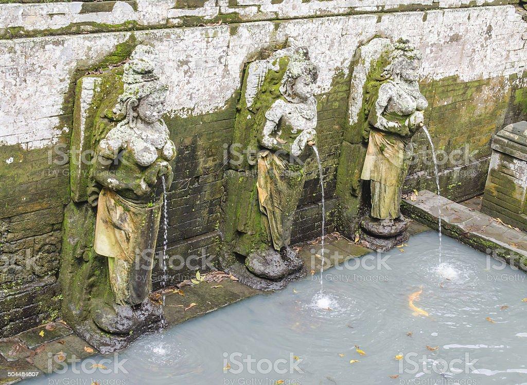 Statues at Goa Gajah Cave in Bali stock photo