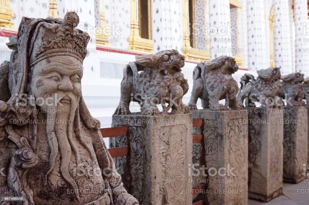Statues at the Wat Arun temple in Bangkok stock photo