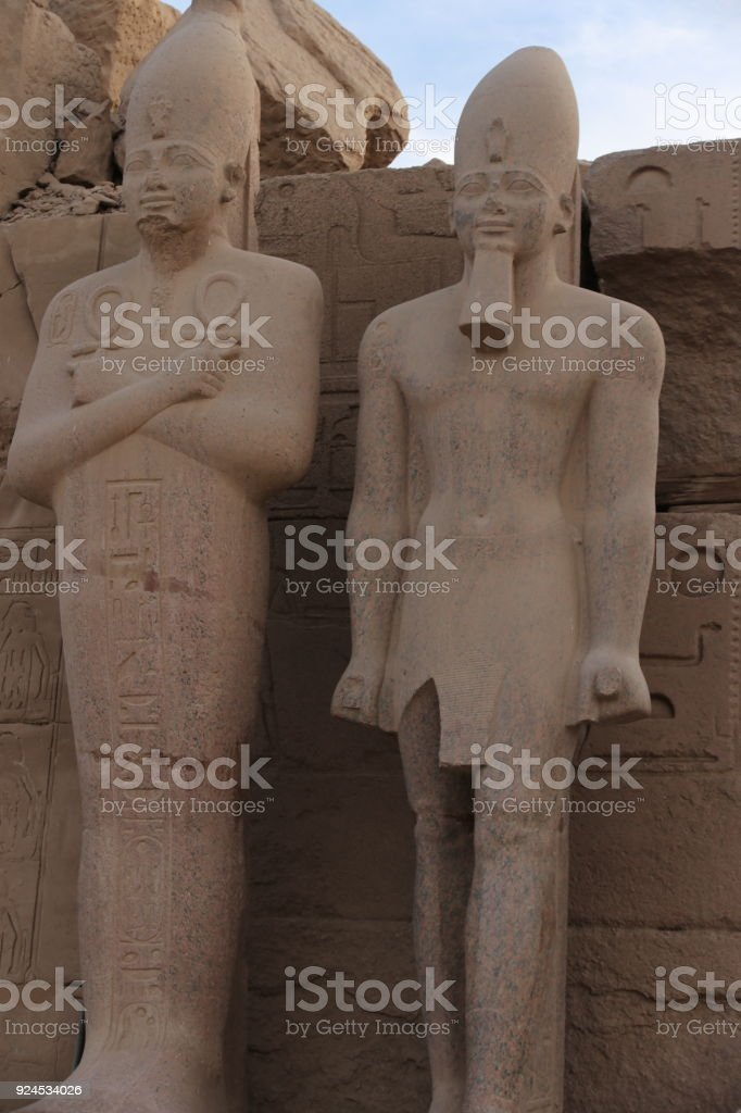 Statues guard an entrance to a Karnak temple stock photo