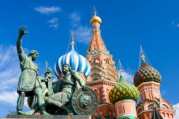Statues in front of St Basil Cathedral with blue sky St.Basil Orthodox Cathedral and Minin & Pozharskiy monument in Moscow,Russia. kremlin stock pictures, royalty-free photos & images