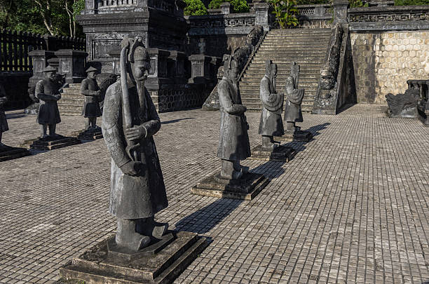 Statues  in Imperial Khai Dinh Tomb in Hue, Vietnam Statues in Imperial Khai Dinh Tomb in Hue, Vietnam khai dinh tomb stock pictures, royalty-free photos & images