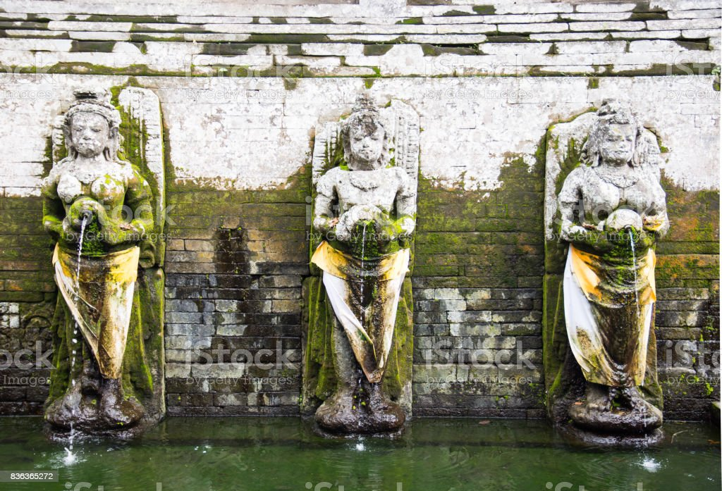statues inside Goa Gajah Temple stock photo