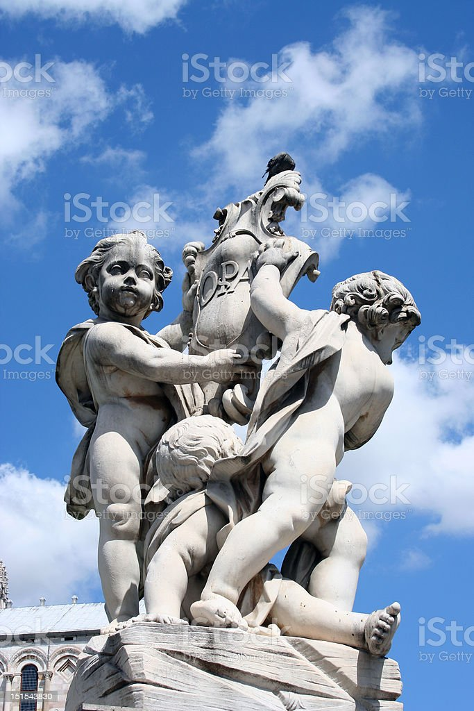 Statues near the leaning tower of Pisa stock photo