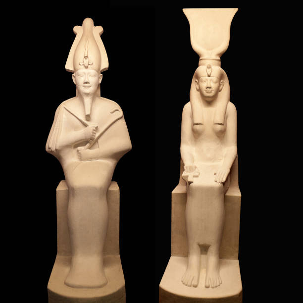 Statues of Egyptian gods Osiris and Isis on black backgroung stock photo