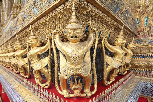 statues of garuda battling naga serpent on the wall - dazzlingly stock pictures, royalty-free photos & images
