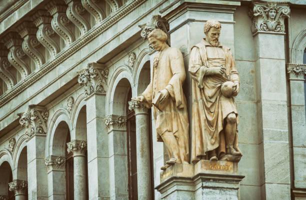 Statues of Mikhail Lomonosov & Galileo Galilei, Budapest, Hungary Budapest, Hungary - July 9, 2015: Statues of Mikhail Lomonosov & Galileo Galilei at Hungarian Academy of Sciences, Budapest, Hungary. galileo galilei stock pictures, royalty-free photos & images