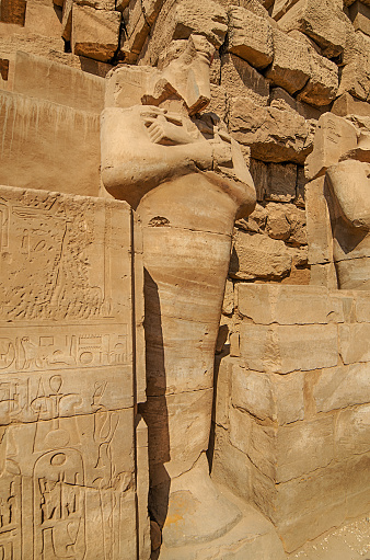 istock Statues of  pharaoh in ancient Egyptian temple of Amun at Karnak 484586648