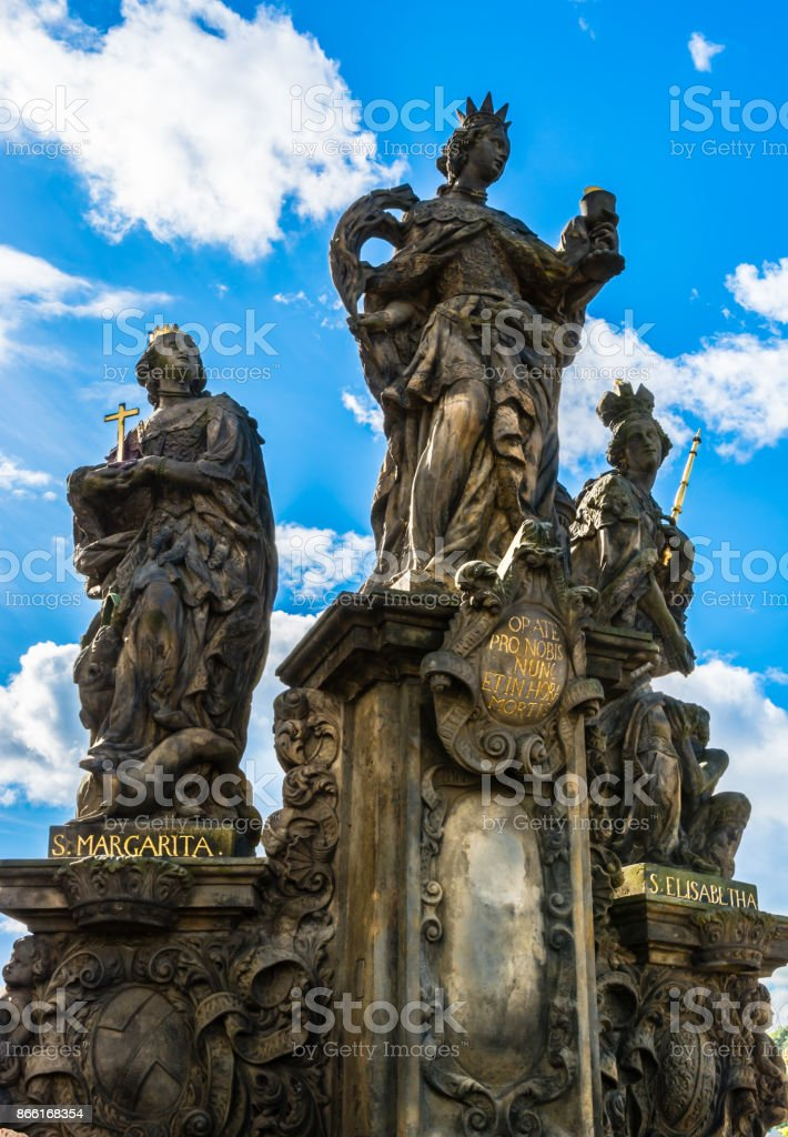 Statues of Saints Barbara, Margaret and Elizabeth on Charles Bridge in Prague stock photo