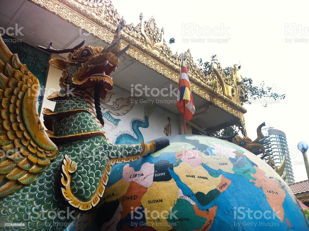 statues of the dragon with wings standing on earth in the garden of Dhammikarama Burmese Temple stock photo