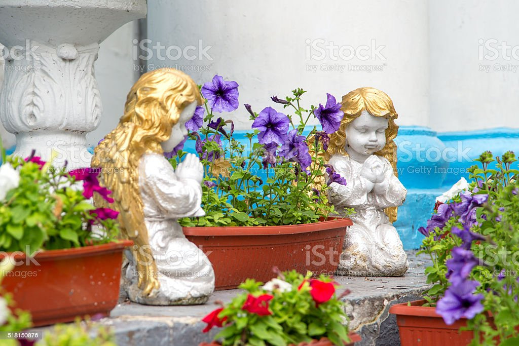 statues of two angels stock photo