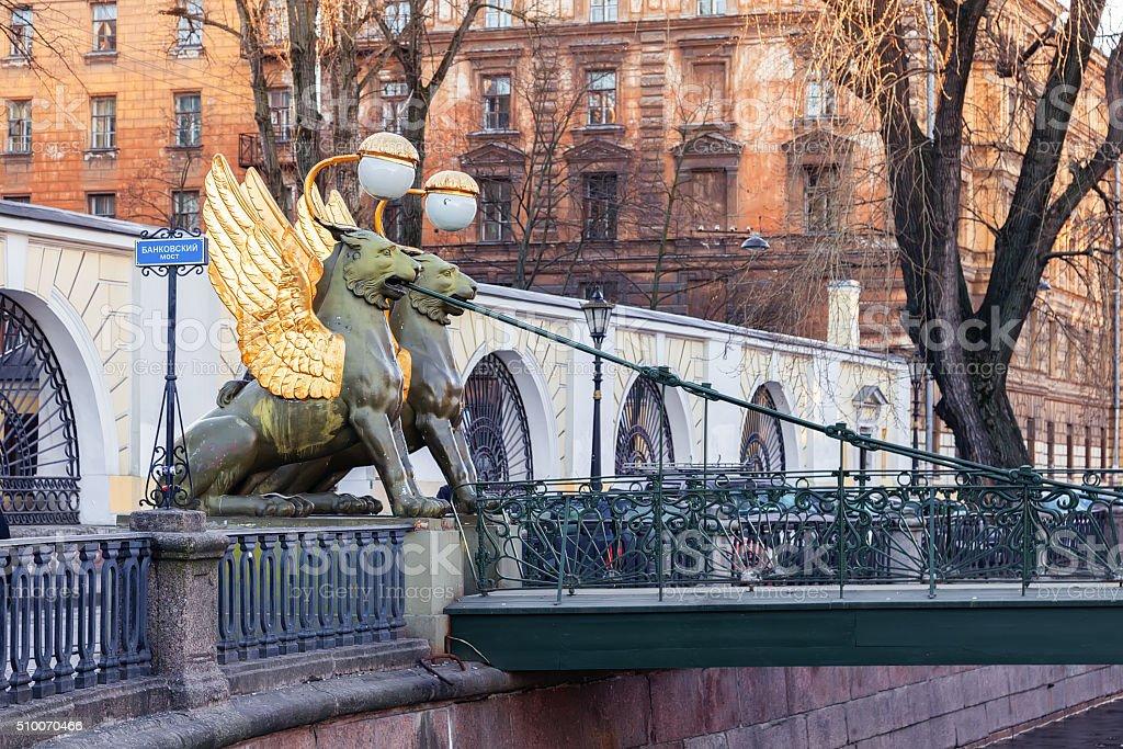 Statues of winged griffons on Bank Bridge in Saint Petersburg stock photo