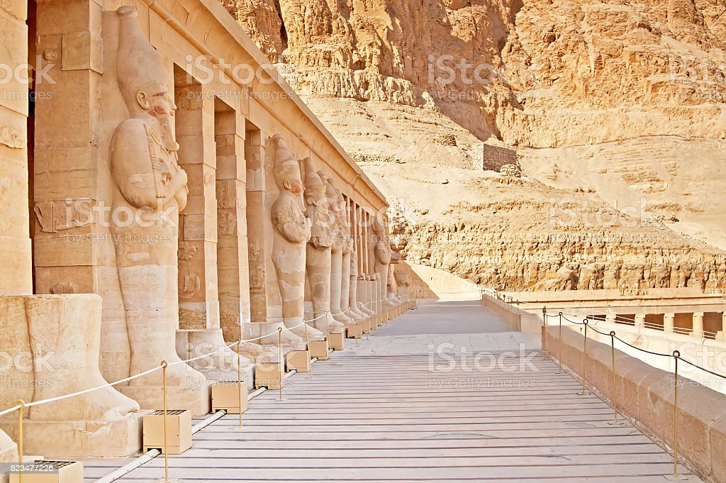 Statues on facade of palace of Hatshepsut in Luxor, Egypt stock photo