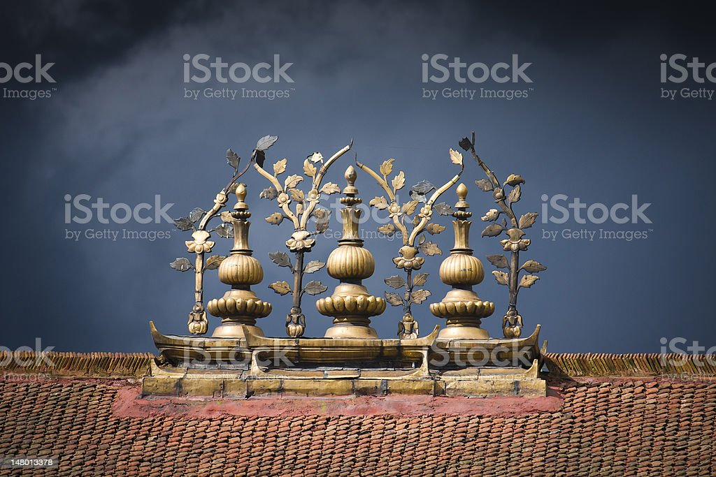 Statues on top of a temple against gloomy sky. royalty-free stock photo