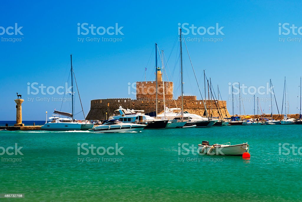 Statues stand either side of Mandraki harbour entrance stock photo