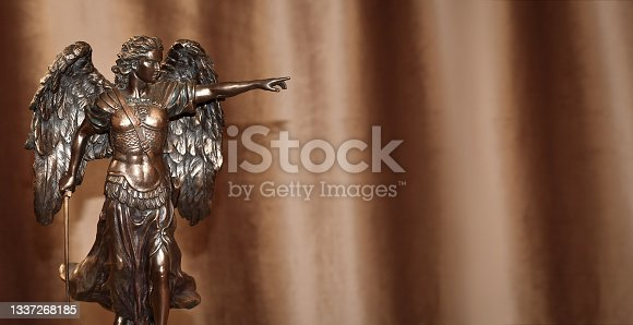 istock Statuette of the Archangel Michael on a velour background. 1337268185