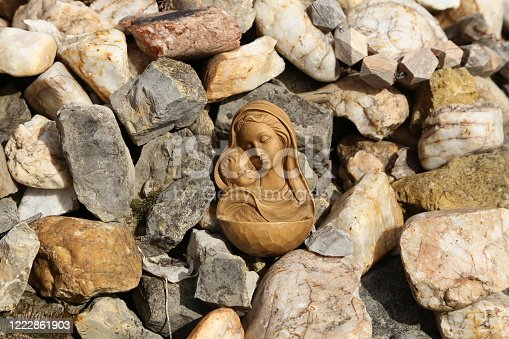 istock Statuette of the Virgin Mary with a baby 1222861903