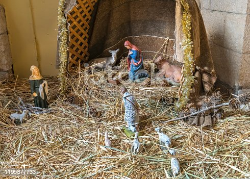 istock Statuettes of Mary, Joseph and baby Jesus,The birthday of Jesus, newborn Jesus on the hay 1195877733