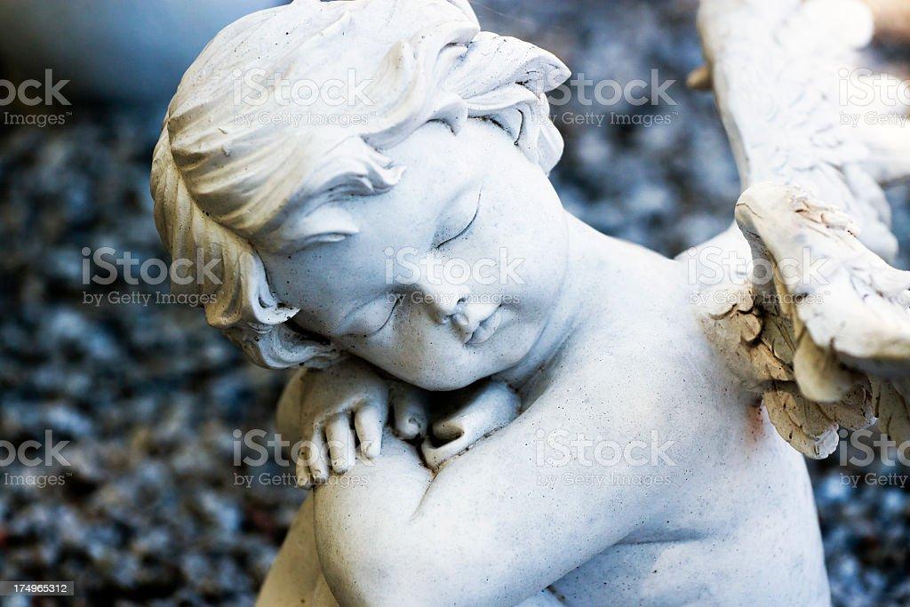 Staue of sleeping little angel - cherub royalty-free stock photo