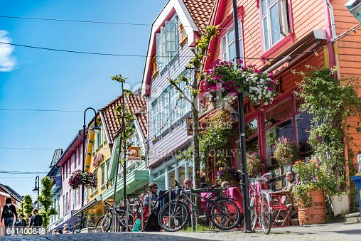 View of the old town streets, people and restaurants in Stavanger, Norway. Stavanger is one of most famous cruise travel destinations in Europe.