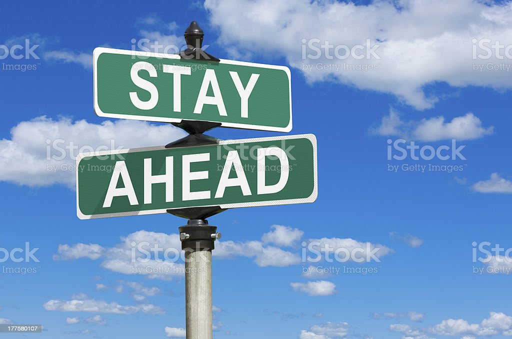 Stay Ahead Street Intersection Sign royalty-free stock photo