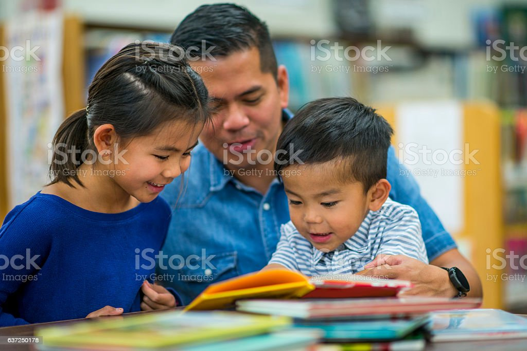Stay at Home Father with His Kids stock photo