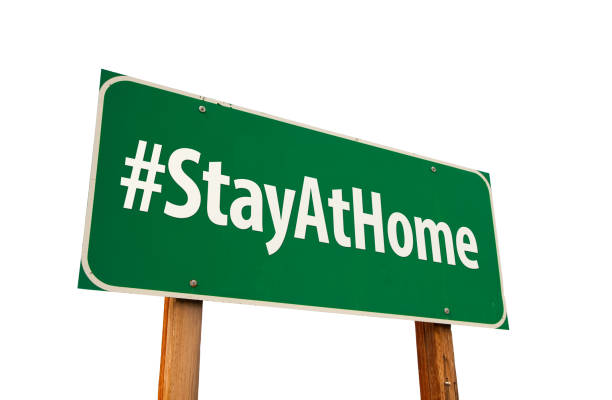 #Stay At Home Green Road Sign Isolated On A White Background #Stay At Home Green Road Sign Isolated On A White Background. stay at home order stock pictures, royalty-free photos & images