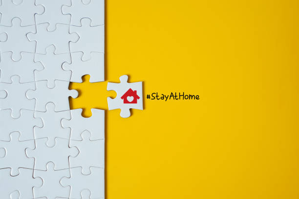 Stay at home. Jigsaw puzzle. stock photo