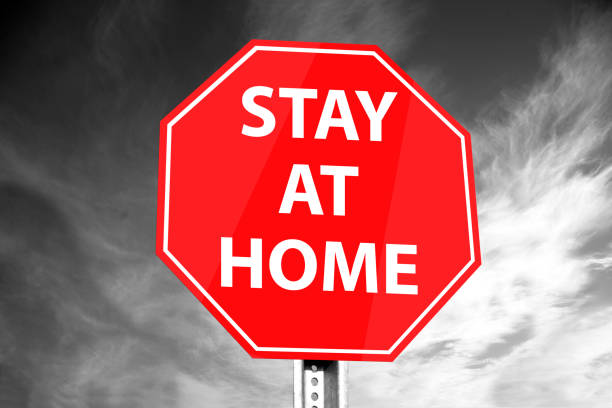 Stay at home road sign. Corona virus concept stock photo