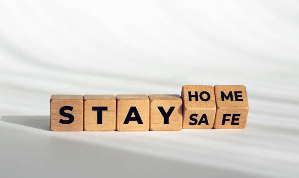 Stay at home stay safe message on wooden dices stock photo