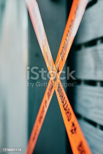 Shot of barrier tape cordoning off a gate