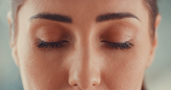 Cropped shot of a young woman closing her eyes