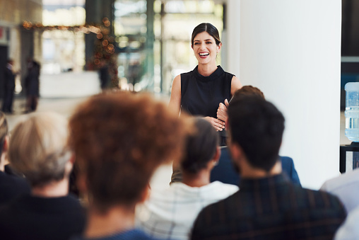 istock Stay current with trends by learning from powerful speakers 1160947373