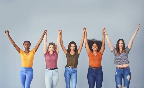 Stay empowered! Studio shot of a group of attractive young women cheering against a gray background body positive stock pictures, royalty-free photos & images