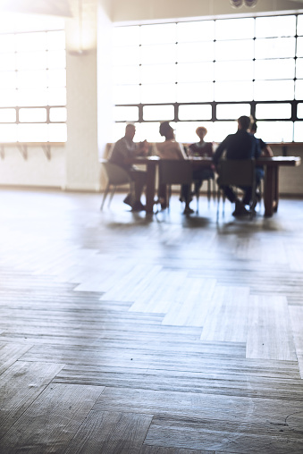Shot of a group of colleagues having an office meeting inside