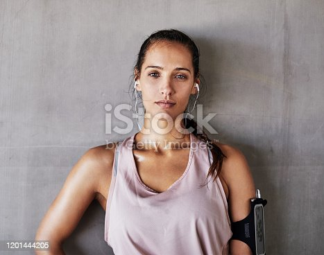 Cropped portrait of an attractive young female athlete working out in the city