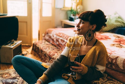 Girl at home drinking red wine