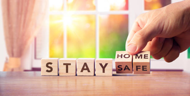 stay home - quarantine concept - hand turn wooden blocks with text message - prevenzione delle malattie foto e immagini stock