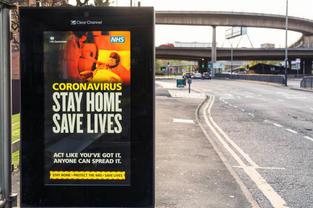 Stay Home Save Lives sign during Coronavirus lockdown measures stock photo