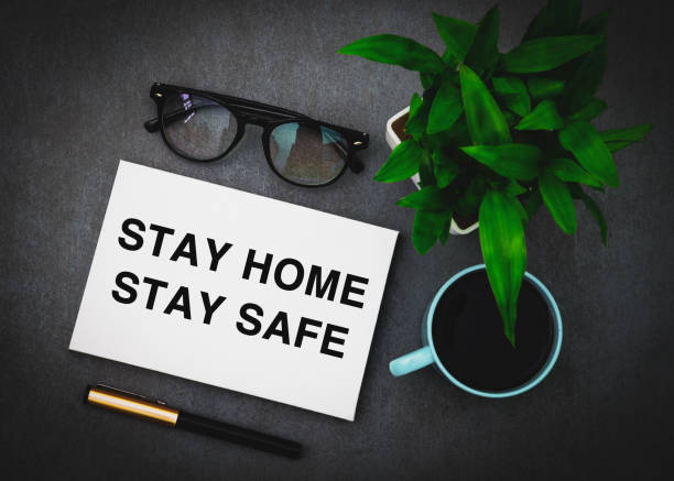 Stay home stay safe written on a white board stock photo